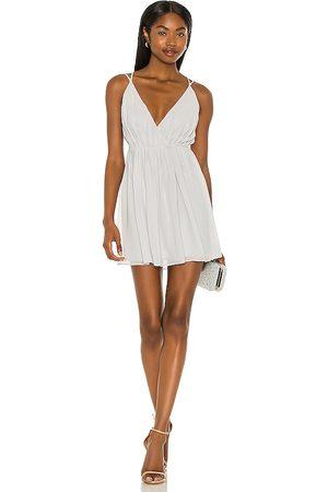 Michael Costello X REVOLE Etta Mini Wrap Dress in - Light Grey,Slate. Size L (also in XXS, XS, S, M, XL).