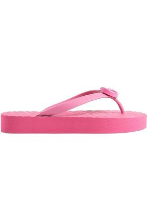 Gucci GG rubber flip flops