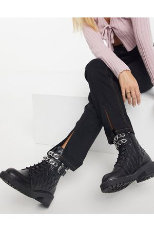 Stradivarius Quilted chain detail boots in