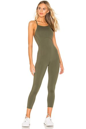Free People X FP Movement Side To Side Performance Jumpsuit in - Olive. Size L (also in XS, S, M).