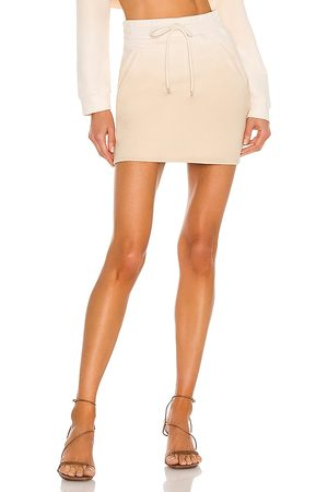 h:ours Malika Mini Skirt in - Neutral. Size L (also in XXS, XS, S, M).