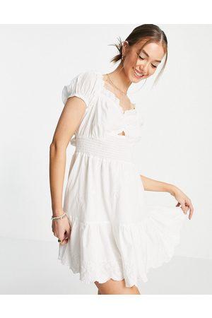 River Island Broderie puff sleeve shirred mini beach dress in cream-White