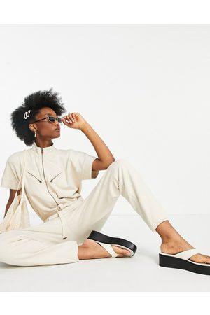AllSaints Kayla utility jumpsuit in off-white