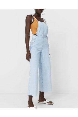 Stradivarius Tie detail slouchy jumpsuit in washed blue