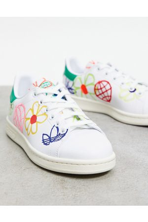 adidas Sustainable Stan Smiths in white with all over graphic print