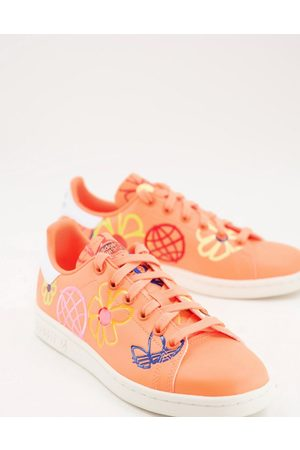 adidas Sustainable Stan Smiths in with all over graphic print