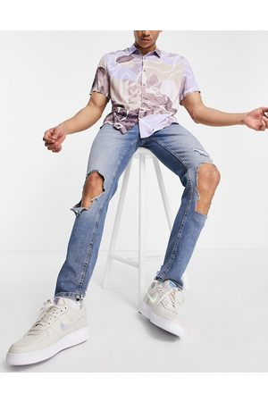 ASOS Skinny jeans in light wash blue with extreme rips