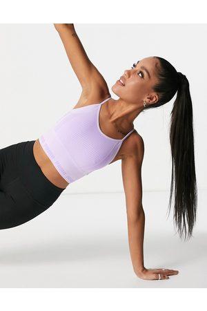 PUMA Training Evoknit seamless light support sports bra in lilac-Purple