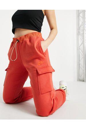 Nike Loose fit fleece cargo pants in burnt orange-Brown