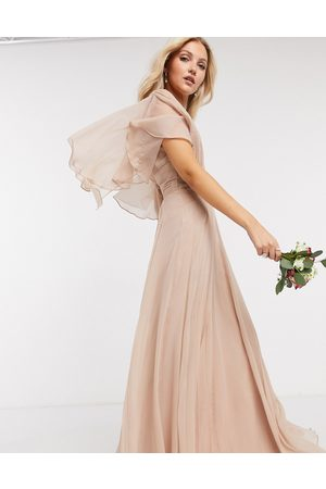 ASOS Bridesmaid ruched bodice drape maxi dress with wrap waist and flutter cape sleeve in blush-Pink