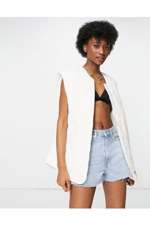 Monki Hanna recycled quilted gilet vest in ecru-Neutral