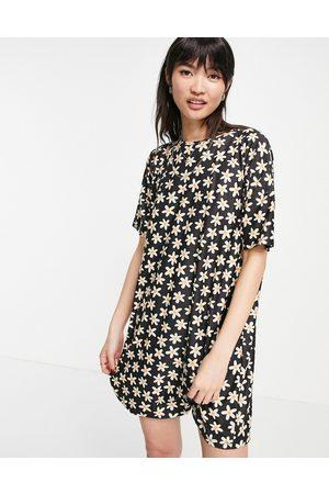 Urban Threads Damen Freizeitkleider - T-shirt dress in daisy print-Black