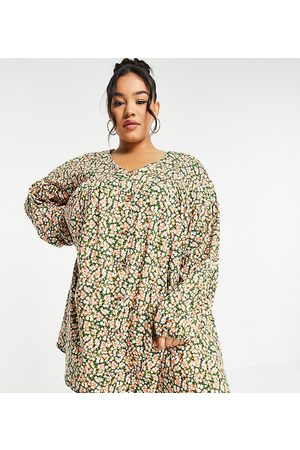 ASOS ASOS DESIGN Curve button through mini smock dress with long sleeves in green and pink floral