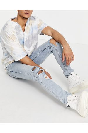 ASOS Skinny jeans in vintage light wash blue with heavy rips