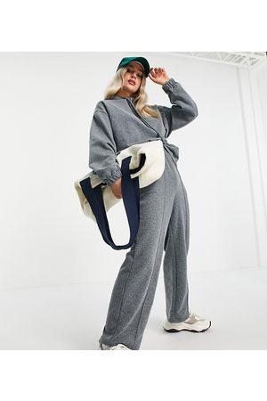 ASOS ASOS DESIGN Petite acid wash tracksuit hoodie and straight leg jogger in charcoal-Grey