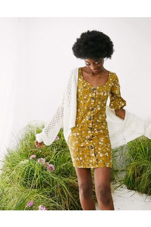 ASOS Mini puff sleeve tea dress with horn buttons in toffee floral print-Brown
