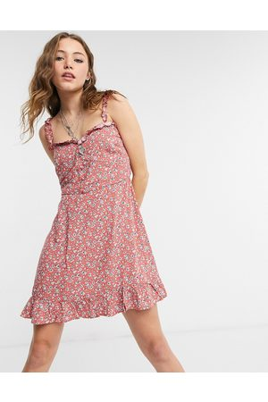 Lottie And Holly Frill hem mini dress in ditsy floral
