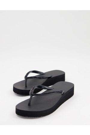 Accessorize Damen Flip Flops - Eva wedge thong flip flops in black