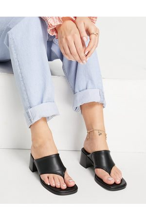 E8 By Miista Crystal toe thing heeled mules in black