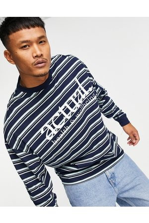 ASOS Oversized long sleeve t-shirt with all over stripe print and chest logo in navy