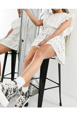 Just Me Frill sleeve tiered mini dress in ditsy floral print-White