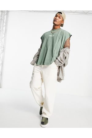 ASOS Oversized vest in green with dipped hem and text print