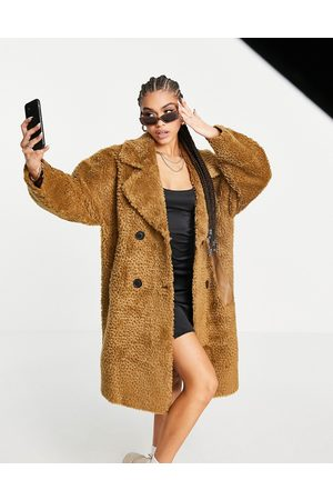 NA-KD Oversized teddy faux leather coat in brown