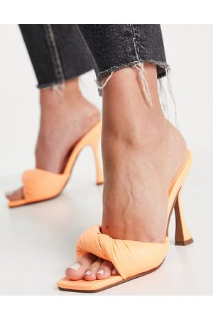 ASOS Hazelnut mid heeled mules in clear