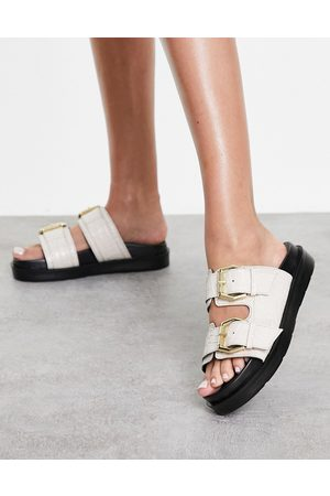 Schuh Tash leather double strap slide sandals in black croc