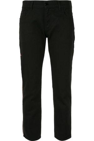 Emporio Armani Damen Skinny - Logo embroidered trousers