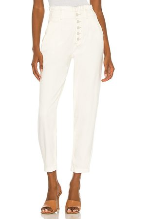 Paige Pleated Carrot Leg Exposed Buttonfly Jean in - White. Size 23 (also in 24, 25, 26, 27, 28, 29, 30, 31).