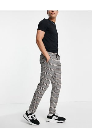 ASOS Slim trousers with elasticated waist in brown check-Grey