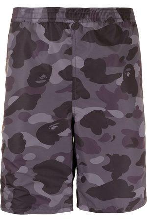 A BATHING APE® Camouflage-print knee-length shorts
