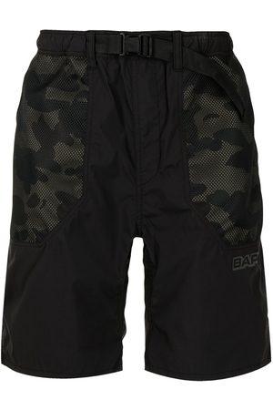 A Bathing Ape Herren Kurze Hosen - Camouflage-print track shorts