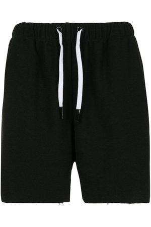 Natasha Zinko X Duo long jogging shorts