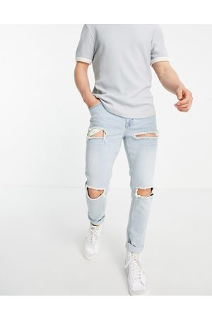 ASOS Skinny jeans with heavy rips in vintage light wash-Blue
