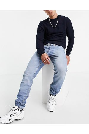 Levi's Levi's 512 slim tapered fit lo-ball jeans in mid wash blue