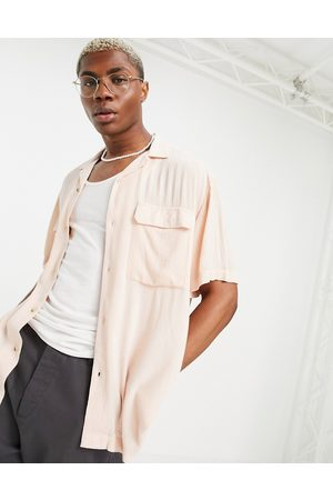 ASOS DESIGN Crinkle viscose shirt with revere collar and pockets in pink