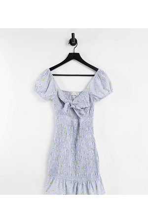 Sisters of the Tribe Mini milk maid dress with shirring in blue floral
