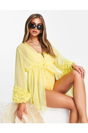Moda Minx Ruffle sleeve beach kimono in lemon-Yellow