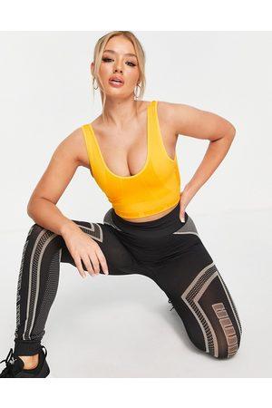 PUMA Damen Sport BHs - Training Contour seamless v neck light support sports bra in orange-Yellow