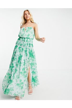 ASOS Strappy maxi dress with ruched channel detail and tie straps in green floral