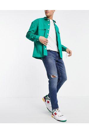 ASOS Herren Slim - Stretch slim jeans in tinted dark wash with abrasions-Blue