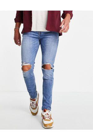 ASOS Herren Skinny - Skinny jeans in mid wash with knee rips-Blue