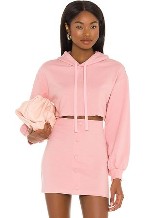 Camila Coelho Laurell Crop Hoodie in - Pink. Size L (also in XXS, XS, S, M, XL).