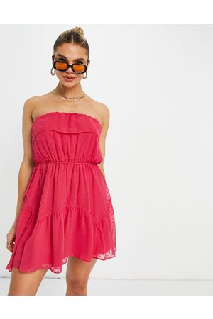 ASOS Ruffle bandeau mini skater dress with belt in dobby in hot pink
