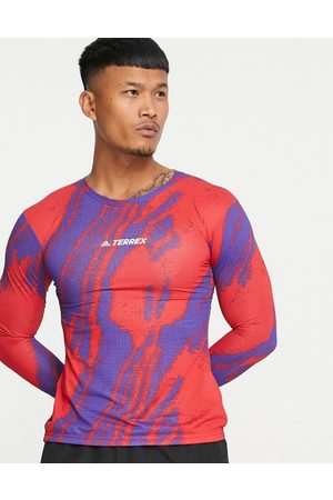 adidas Adidas Terrex Outdoors Trail GFX long sleeve t-shirt in red and purple print