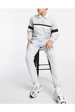 ASOS Stretch slim jeans in 90's bleach wash with rips-Blue