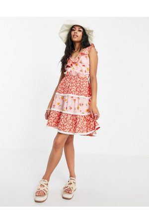 ASOS DESIGN Dobby tiered mini skater sundress with lace up back in mixed floral-Multi