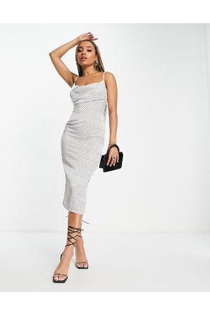 Koco & K Cowl front dipped back midi dress in white polka print-Multi